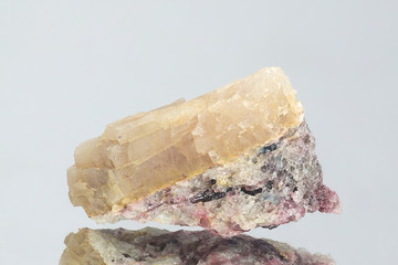 Crystal of major industrial lithium ore spodumene.  Sample from Haapaluoma lithium quarry in Finland.
