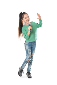 Little girl singing into microphone on white background