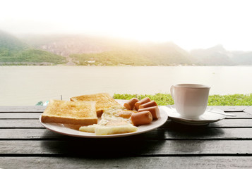 bread egg suacess breakfast with mountain view in holiday