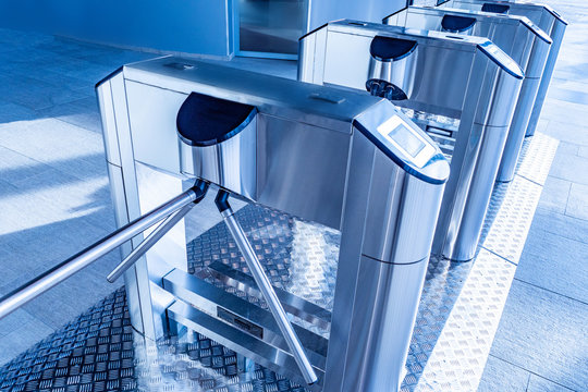 Turnstiles. Checkpoint. Automatic access control. Access system in the building. Automatic turnstile with sliding doors to control the flow of people. Entrance hall with turnstile