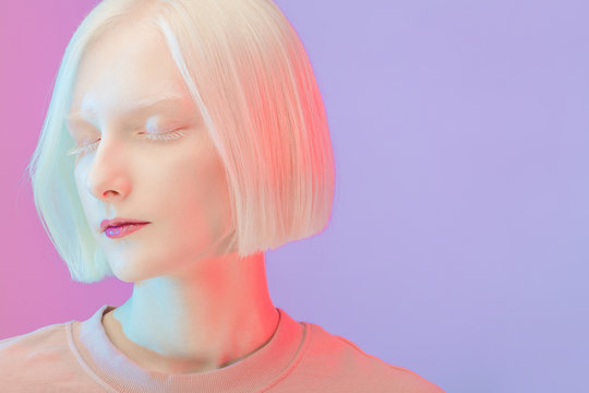 closed up photo. calm gorgeous girl with a pale face, isolated pink background