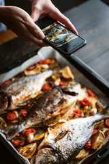 food photographer shoots a finished dish