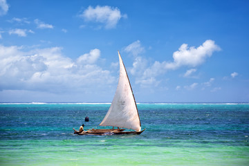 Wall Mural - Traditional Zanzibar fishing boat in tropical ocean, Tanzania