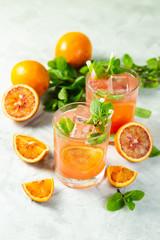 Bloody orange drink and ingredients, copy space