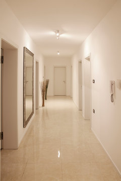 hallway with large wall mirror