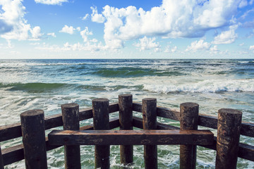 Fototapete - horizontal line of sea waves and wooden balls
