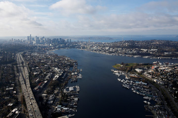 An aerial photo shows the Ship Canal Bridge on I-5 heading into downtown Seattle with Lake Union on the right in Seattle