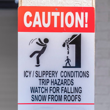 Caution sign on a snowy area in winter