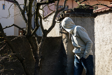 Burglar or thief or robber is checking the situation before break into house