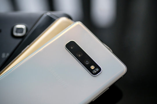 Samsung Galaxy smartphones piling on the table