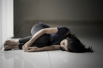 Skinny woman lying on the floor