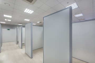Open office cubicle workplace. Unfurnished cubicles
