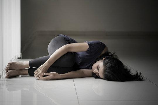 Skinny woman lying on the floor