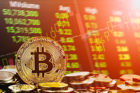 Bitcoin cryptocurrency stock trading background concept. Golden bitcoin over many international money coins with abstract trading green market data chart background.