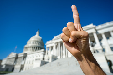 Hand of a proud America First protestor gesturing with a single index finger pointing skyward in front of the Capitol Building in Washington, DC, USA Fotobehang