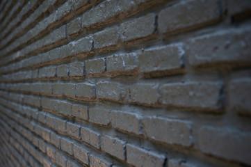 side angle of textured black brick wall interior loft background