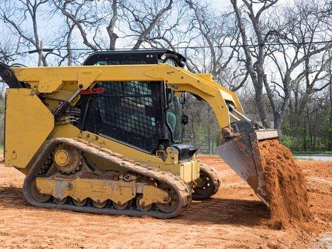 Skid Steer Loader Dumping Dirt Close Up