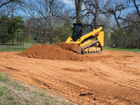 Skidsteer Getting a Bucket of Dirt