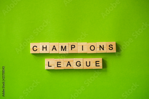 The word CHAMPIONS LEAGUE shot flat lay on a green isolated