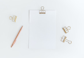 Top view of white notepaper with paperclip on worktable.minimalist style