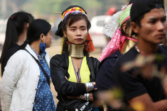 An ethnic Kayan woman also known as a long neck villager arrives at a polling station in Ban Huadua school to cast her vote for the general election in Mae Hong Son