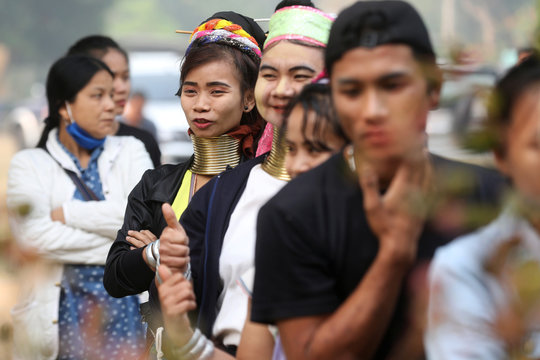 Ethnic Kayan also known as long neck villagers arrive at a polling station in Ban Huadua school to cast their vote for the general election in Mae Hong Son