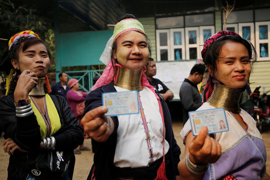 Ethnic Kayan also known as long neck villager arrive at a polling station in Ban Huadua school to cast their vote for the general election in Mae Hong Son