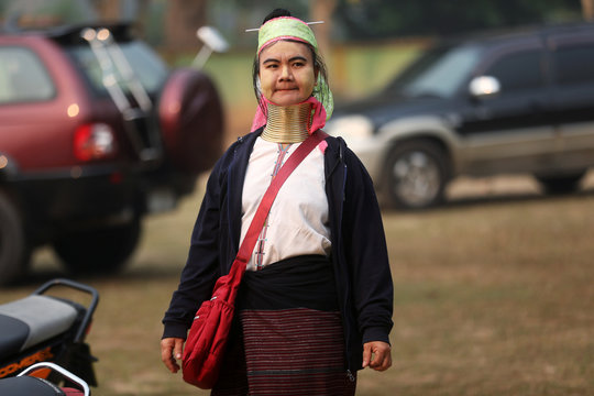 An ethnic Kayan, also known as a long neck villager arrives at the polling station in Ban Huadua school to cast her vote for the general election in in Mae Hong Son