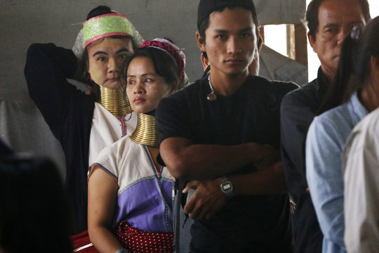 A long neck villager wait to cast her vote for the general election in Mae Hong Son