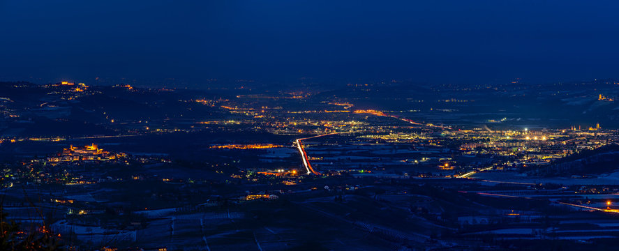 Panorama of Langhe near Alba city in winter at blue hour