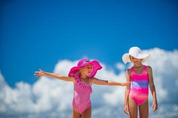 Happy kids travel on a white san tropical ocean beach resort