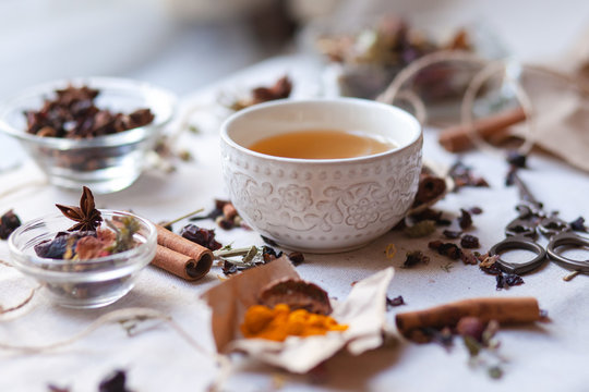 Indian spa, relaxation,  herbal tea ceremony. Dry leaves, spices, cinnamon, anise, curcuma, dry fruits and vegetables. Vintage scissors, craft paper and rope as decoration.