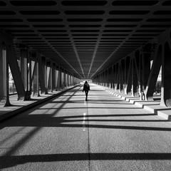 Girl walking over bridge