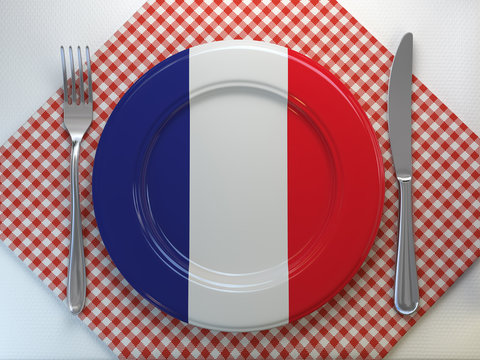 French cuisine  or rfrench estaurant concept. Plate with flag of France with knife and fork.