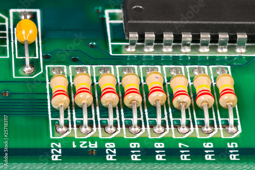 Integrated circuit, resistors and capacitor soldered on PCB