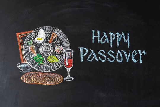 Passover plate and traditional food for Passover (Pesach) on chalkboard. Passover dinner, seder pesach.