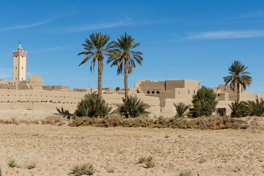 Fortified city of Erfoud along the former caravan route between the Sahara and Marrakech in Morocco with snow covered Atlas mountain range in background