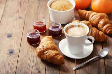 cup of coffee and croissants with fruit jam