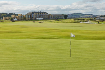 """St. Andrews Clubhouse and Golf Course of the Royal & Ancient where golf was founded in 1754, considered by many to be the """"home of golf""""."""