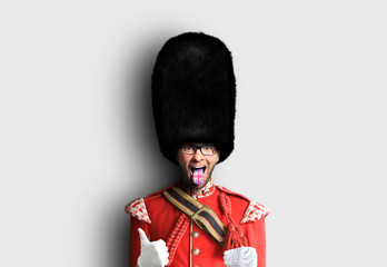 Young man in the costume of the Royal guards of Britain Fototapete