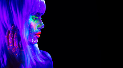 Wall Mural - Fashion model woman in neon light. Beautiful model girl with colorful bright fluorescent makeup isolated on black. Ultraviolet, UV