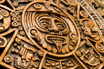 Oblique view of the central disk of the Aztec calendar, with the face of the solar deity Tonatiuth