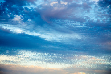 Bright blue sky with gentle cumulus clouds. Pink vanilla heaven. Natural summer and spring...