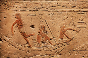 People on riverboat, relief on ancient Tomb of Sakkara, made at 2300 BC in Egypt, saved by Carlsberg Glyptotek