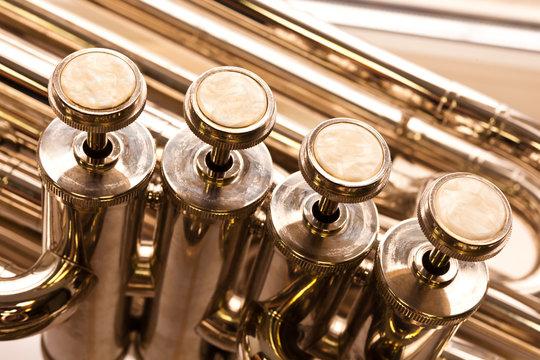 Fragment of a bass tuba valves closeup