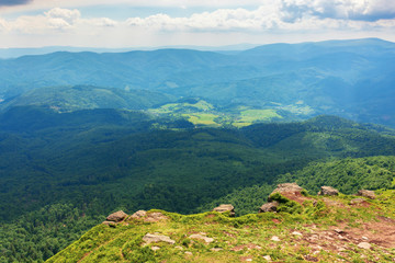 mountains, valleys of carpathians. beautiful landscape with polonina runa mountain in the distance. view from Pikui peak of watershed ridge.