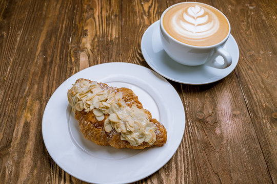 the almond croissant with a cappuccino