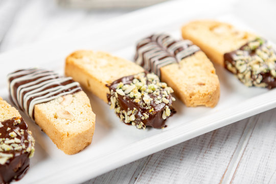 Cantuccini biscuits with chocolate and pistachios. Italian biscotti on white plate