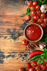 Fototapeta Fresh homemade ketchup with ingredients for making.Top view with copy space. obraz