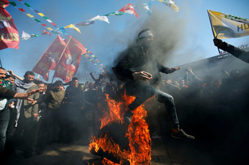 People gather to celebrate Newroz, which marks the arrival of spring and the new year, in Istanbul